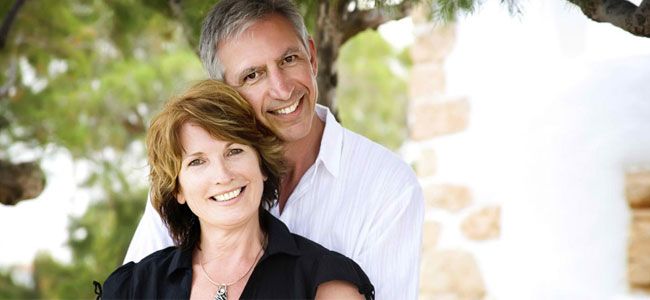 A smiling couple illustrates how Dental Implants at our Naperville practice can restore your smile.