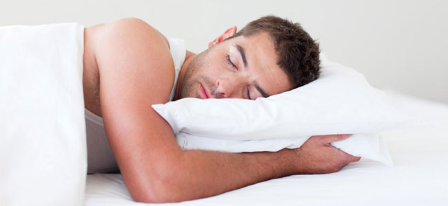 A sleeping man shows how our Naperville Dentistry experts help patient suffering from Sleep Apnea.