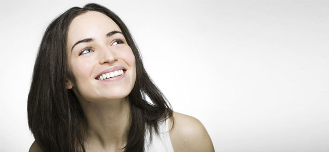 A smiling woman illustrates how our Cosmetic Dentistry experts in Naperville use smile design to transform your smile.