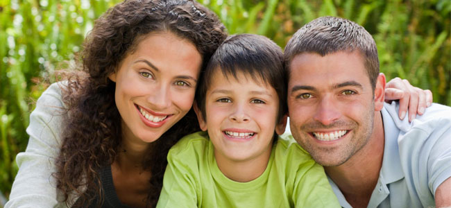 A smiling family illustrates how general dentistry with our Naperville Dentists keep your smile healthy.