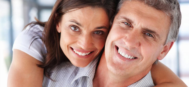 A smiling couple illustrates how our Shorewood Dentists use metal-free fillings to keep your smile looking it's best.