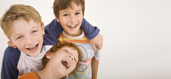 Smiling kids illustrate Dr. Lakota's focus on Family Dental care in his Shoreline practice.