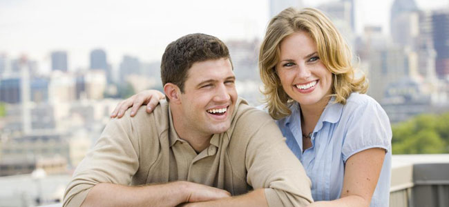 A smiling couple illustrates how Dr. Lakota takes the anxiety out of Root Canal treatment at his Naperville practice.