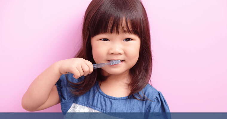 Little girl brushes her teeth after a back-to-school dental check up!